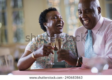 Couple Drinking Champagne in Restaurant - stock photo