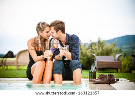 Couple drinking wine in cheerful moment - Stock Image - stock photo