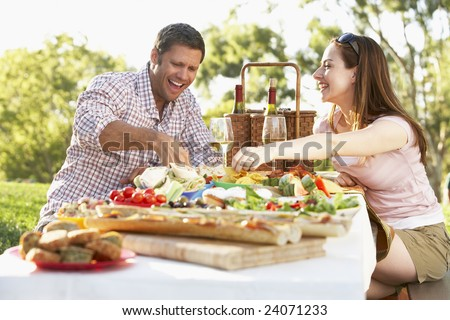 Couple Eating An Al Fresco Meal - stock photo