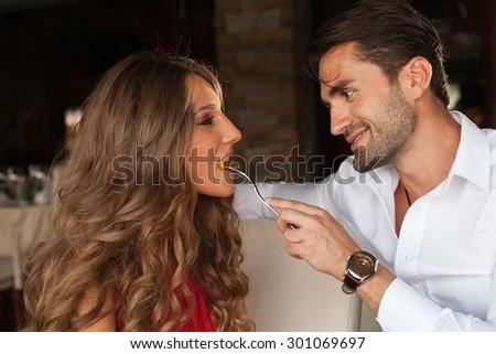 Couple eating in restaurant. Romantic dinner. - stock photo