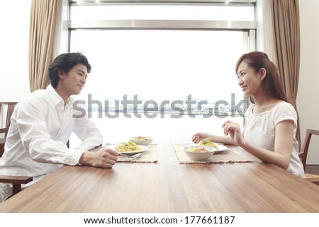 Couple eating lunch while talking - stock photo