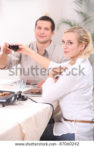 Couple eating meal at home - stock photo