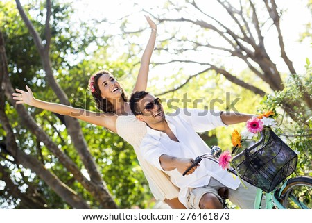 Couple enjoying a spring day biking in nature - stock photo