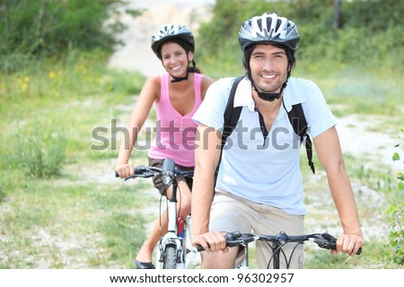 Couple enjoying bike ride - stock photo