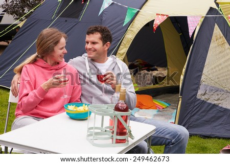 Couple Enjoying Camping Holiday On Campsite  - stock photo