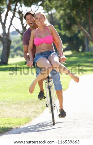 Couple Enjoying Cycle Ride - stock photo