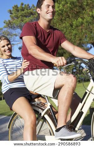 Couple Enjoying Cycle Ride - stock photo