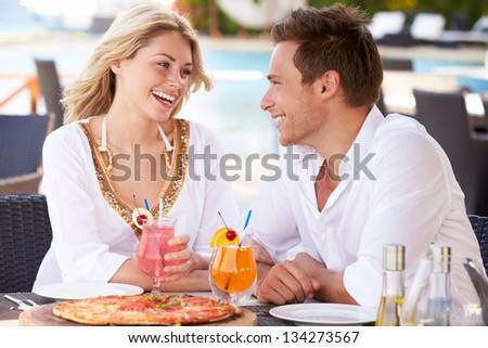 Couple Enjoying Meal In Outdoor Restaurant - stock photo