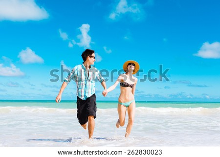 Couple enjoying the beach in beautiful Hawaii - stock photo
