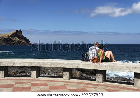 Couple enjoying the ocean landscape - stock photo
