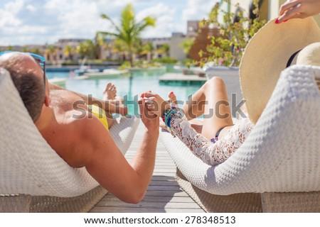Couple enjoying vacation in luxury resort - stock photo