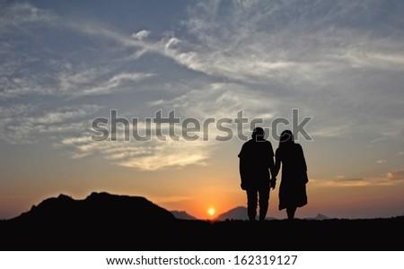 Couple Evening Walk - stock photo