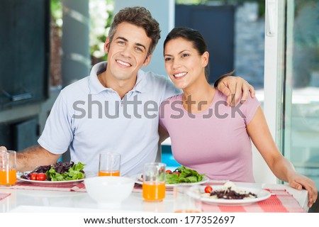 couple family lunch home, eating happy love smile, sitting at dinner table - stock photo