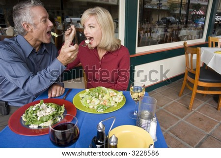 Couple feeding each other - stock photo