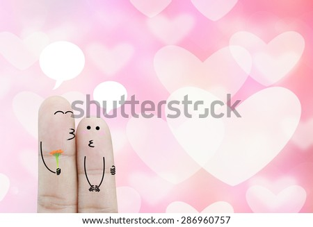 Couple Finger  in love and bubble chat on bokeh heart background   , concept - stock photo