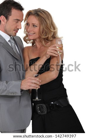 Couple flirting and drinking champagne - stock photo