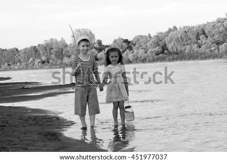 couple, funny boy and girl on the river summer day.Black and white photo stylized vintage style - stock photo