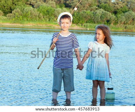 couple, funny boy and girl on the river summer day.toned - stock photo