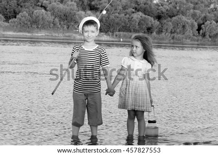 couple, funny boy and girl summer portrait of friend.Black and white photo stylized vintage style  - stock photo