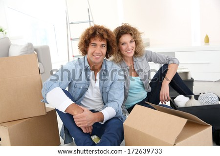 Couple getting in their new apartment to live together - stock photo