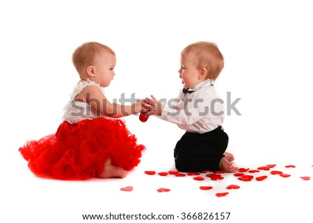 couple girl and boy kids babies playing with hearts concept valentine's day, communication, interaction, love, - stock photo