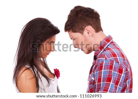 couple going head to head in an argument isolated over a white background - stock photo