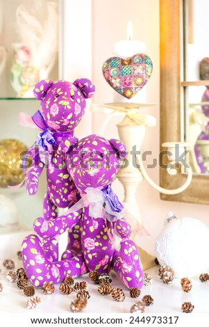 Couple handmade provence purple tilda bear toys on christmas background. Celebration gift. Indoors still-life. - stock photo