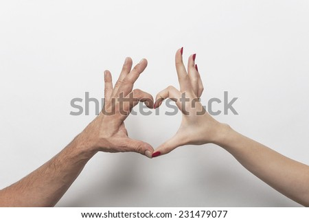 Couple hands making heart gesture - stock photo
