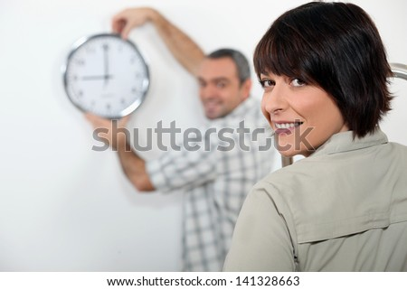 Couple hanging clock - stock photo
