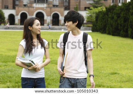 Couple happy college student at a campus - stock photo