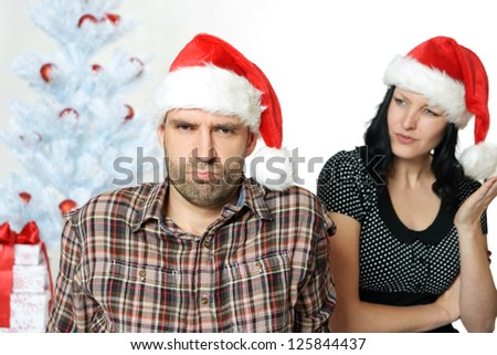 couple has an argument under the christmas tree - stock photo