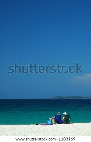 Couple Have a Rest on a Beach - stock photo