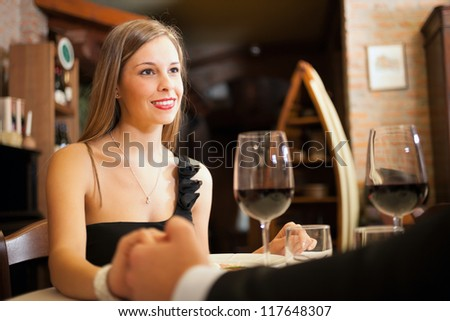 Couple having a date in a luxury restaurant - stock photo