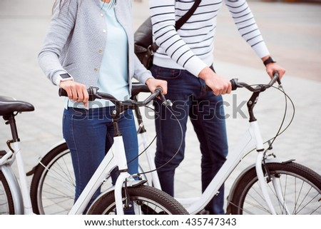 Couple having a date on bikes - stock photo