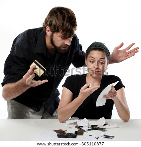Couple having a fight about finances and spending  - stock photo