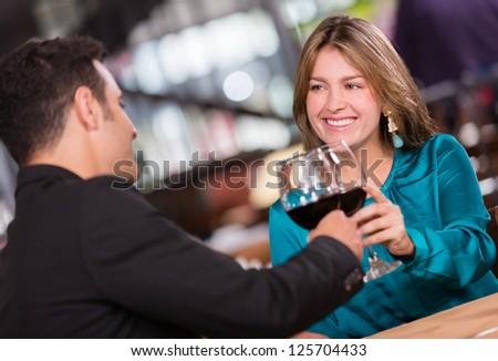 Couple having a romantic dinner at the restaurant - stock photo