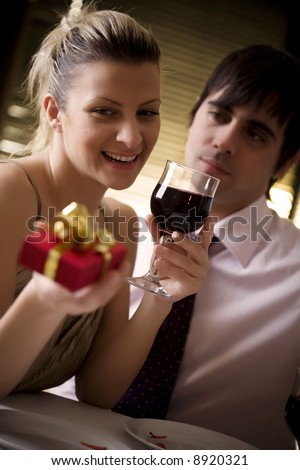 couple having a romantic dinner in restaurant, (or home) - stock photo