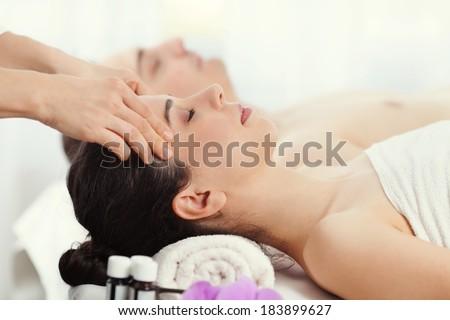 Couple having a spa treatment - stock photo