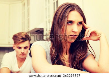 Couple having an argument in the kitchen. - stock photo