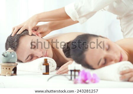 Couple having aromatherapy treatment in the spa - stock photo