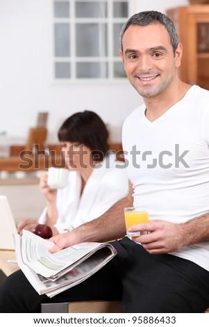 couple having breakfast - stock photo