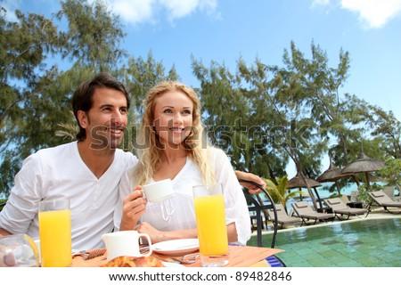 Couple having breakfast in luxury resort - stock photo
