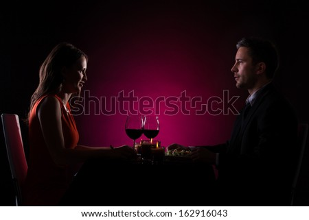 Couple Having Dinner With Wine Glass On Table - stock photo