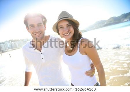 Couple having fun at the beach - stock photo