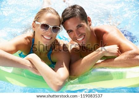 Couple Having Fun In Swimming Pool - stock photo