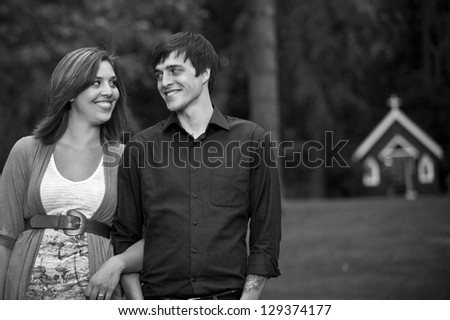 Couple having fun with each other outdoors - stock photo