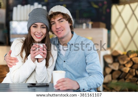 Couple having hot drink on winter day  - stock photo