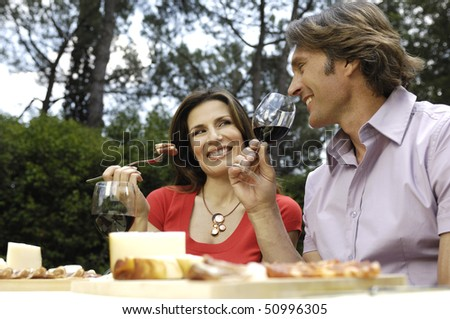 couple having meal outdoor - stock photo