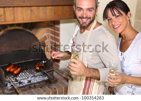 couple having nice time near the fireplace - stock photo