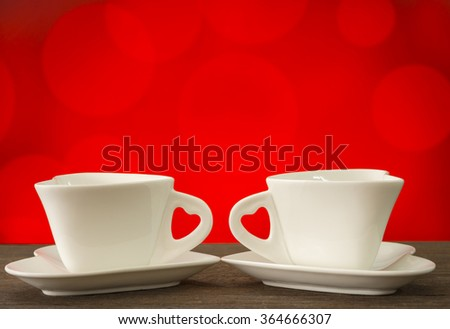 Couple heart-shaped coffee cup white with red background bokeh. Valentine Couple Concept - stock photo